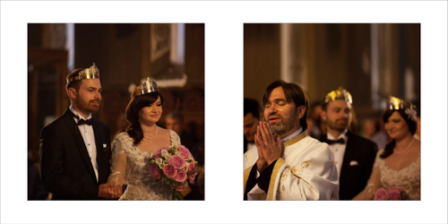 Bride and groom wearing the wedding crowns and the priest praying
