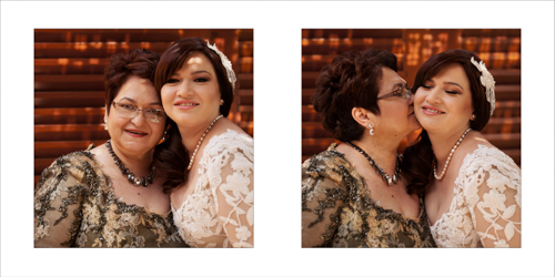 Bride being kissed by her dear mother